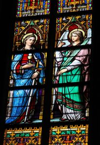 'S HERTOGENBOSCH, THE NETHERLANDS - JULY 23, 2011: Stained Glass Window depicting Saint Barbara with tower, sword, chalice and Eucharist and an angel in Den Bosch Cathedral, North Brabant.